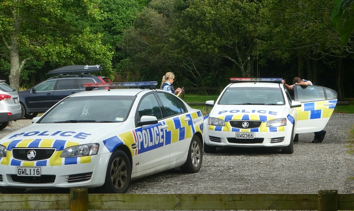 Police at the Waiwhakaiho River in New Plymouth.