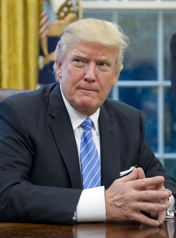 United States President Donald Trump prepares to sign three Executive Orders on 23 January, including one concerning the withdrawal of the Trans-Pacific Partnership (TPP).