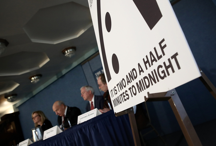 "Members of the Bulletin of Atomic Scientists unveil the 2017 time for the ""Doomsday Clock"" on January 26, 2017 in Washington, DC."