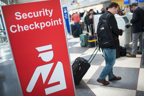 A sign directs travellers to a security checkpoint staffed by Transportation Security Administration (TSA) workers at O'Hare Airport in Chicago, Illinois in June 2015.