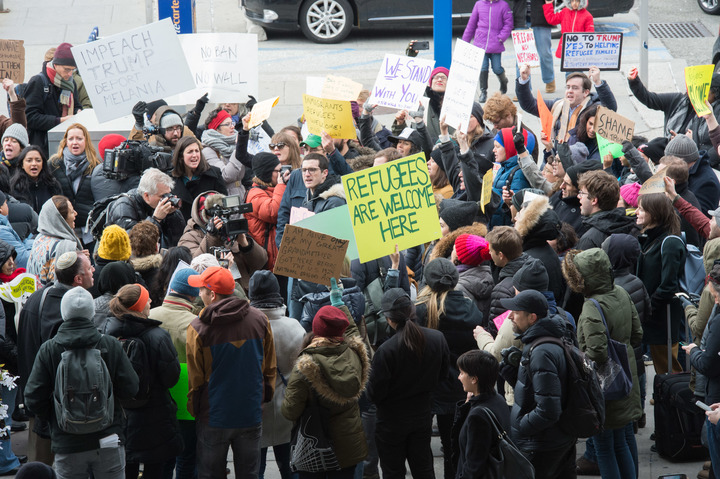 Protesters gather at JFK International Airport's to demonstrate against Donald Trump's executive order.