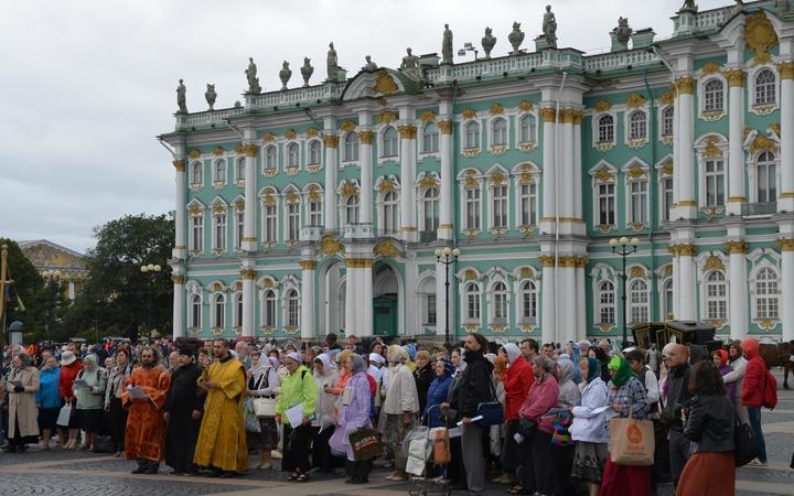 Orthodox supporter of the former Russian monarchy gather outside former Winter Palace in St Petersburg