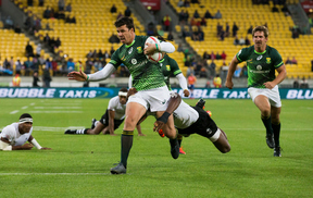 South Africa's Ruhan Nel on his way to a try in the Wellington Sevens final against Fiji.