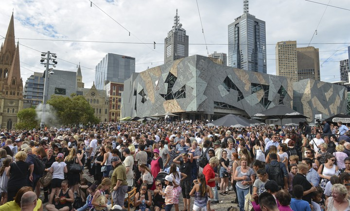 People pay their respects to the Bourke Street victims at Federation Square in Melbourne last Monday.