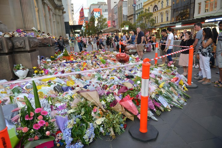 Floral tributes to the victims were laid along the street in the days after the crash.