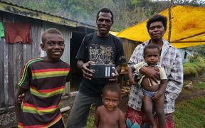 Chief Ben Lovo and his family of Bongkil Village on Erromango, Vanuatu. He says shortwave broadcasts from RNZI during Cyclone Pam allowed him to warn four villages.