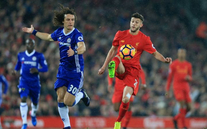 David Luiz of Chelsea battles with Adam Lallana of Liverpool.