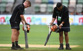 Ground staff try to dry the wicket block, McLean Park, Napier.