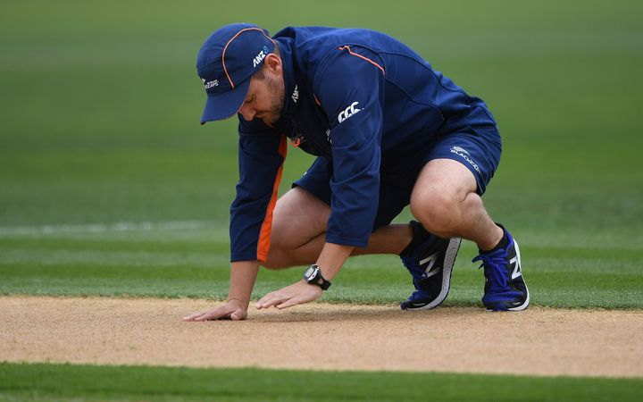 Coach Mike Hesson inspects the wicket during a rain delay. International One Day Cricket. New Zealand Black Caps v Australia. Chappell–Hadlee Trophy, Game 2. McLean Park, Napier, New Zealand. 2 February 2017