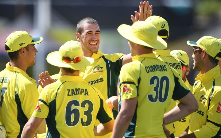 Mitchell Starc and team mates celebrate the wicket of Latham.