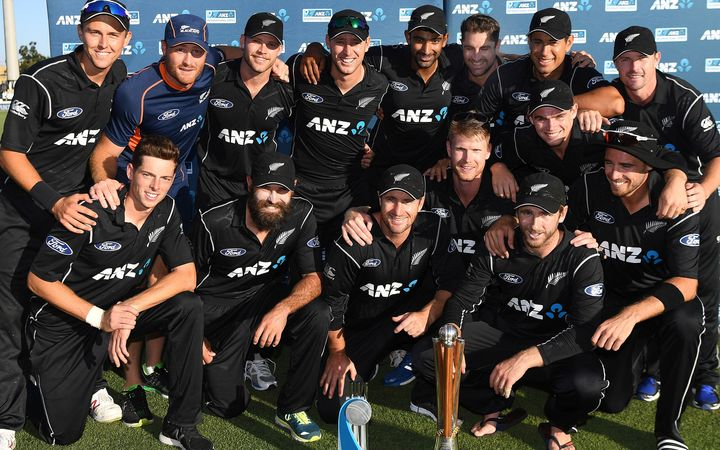 The Black Caps pose with the silverware.