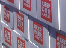 Boxes containing the petition calling for a referendum on asset sales.