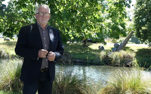 Ecan Councillor, Peter Scott, stands by River Avon
