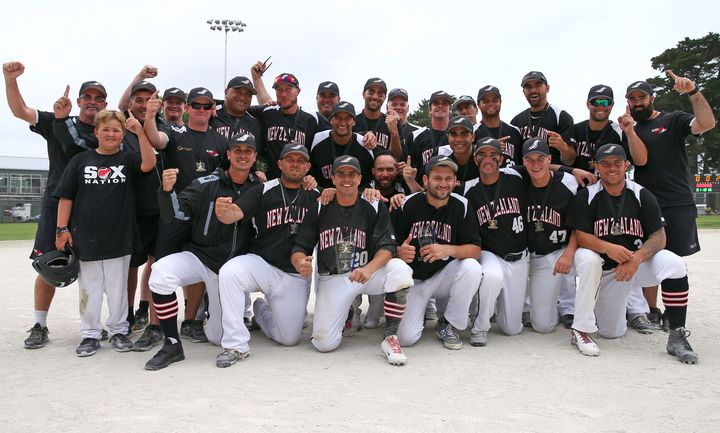 The Black Sox pose with the Challenge Cup trophy.