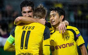 Dortmund, Germany. UEFA Champions League football, Borussia Dortmund. Nuri Sahin (Dortmund) celebrates his goal with Marco Reus (Borussia Dortmund 11) and Shinji Kagawa.