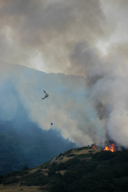 A helicopter fights the fire near Governors Bay in Christchurch's Port Hills.