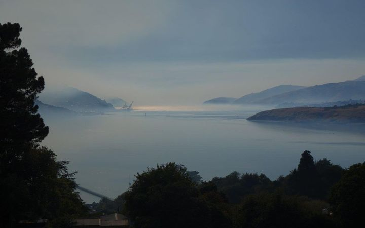 Smoke on the water of Lyttelton Harbour, caused by the Port Hills fires.