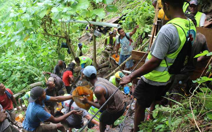 Villagers from Tuatua on Koro Island working with the Fiji Red Cross to construct a spring protection system for the village's drinking water.
