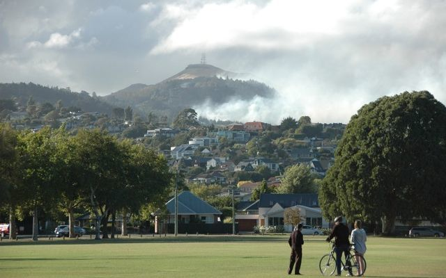 Locals watch the smoke rising from the huge fires overlooking Christchurch.