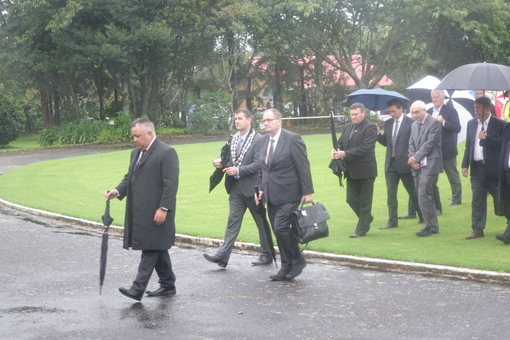 Select committee chair Chester Borrows and New Plymouth District Mayor Neil Holdom are welcomed onto Owae Marae.
