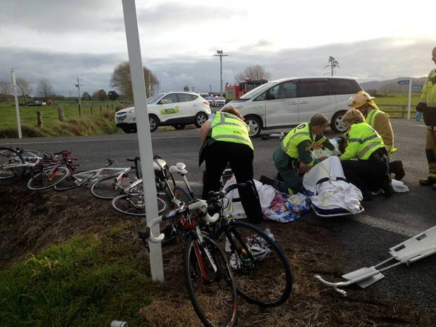 Paramedics tend to one of the cyclists.