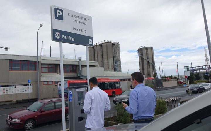 Parkers use one of the new pay-by-plate parking machines that have appeared at some Auckland car parks.