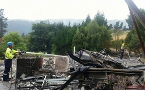 Residents sift through charred remains of homes as cordons lifted