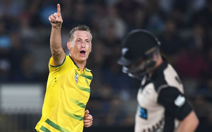 South Africa's Chris Morris celebrates the dismissal of Colin Monroe.