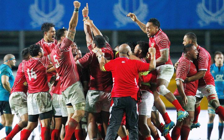 Tonga rugby players celebrate.