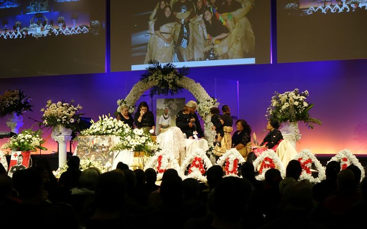 The family of Sione Lauaki, including wife Stephanie (second left), say their farewells.