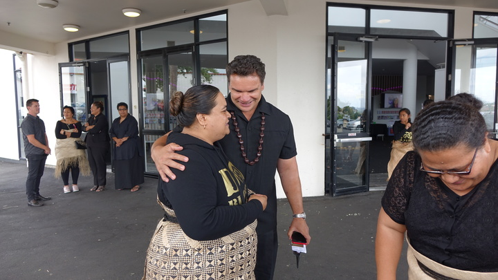 Sione's sister Paenga Kovi Lauaki being comforted by former All Black great Michael Jones.