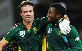 AB de Villiers hugs Andile Phehlukwayo as they win the match.