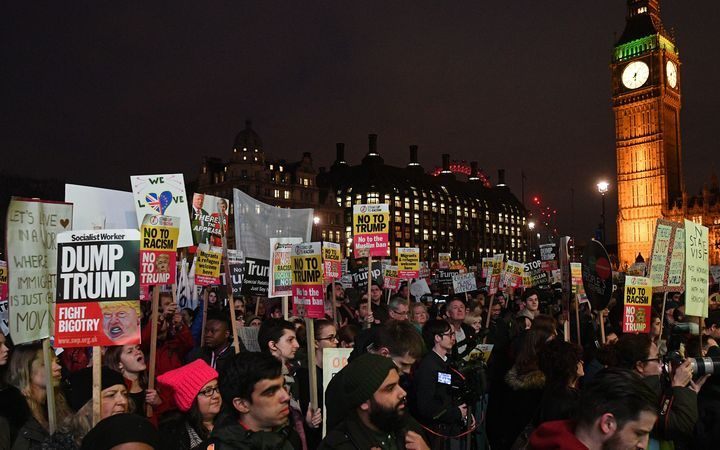 Protesters outside the British parliament as MPs debate  whether Donald Trump's state visit should be blocked.