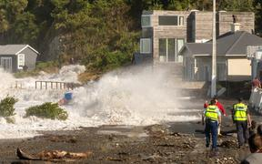 A bridge near Ōwhiro Bay is damaged after massive swells overtook the area.