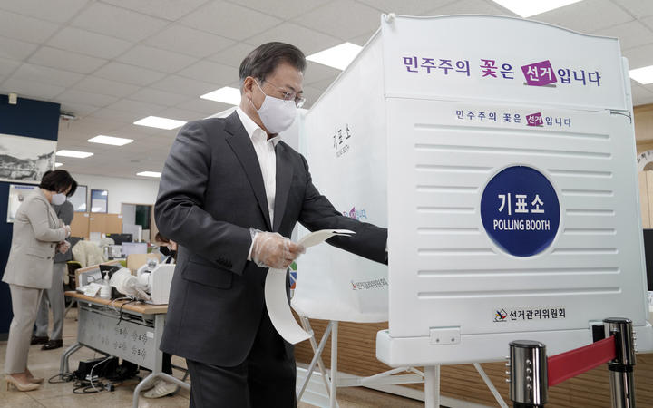 South Korean President Moon Jae-in casting his early ballot for the upcoming parliamentary elections at a polling station in Seoul on 10 April, 2020.