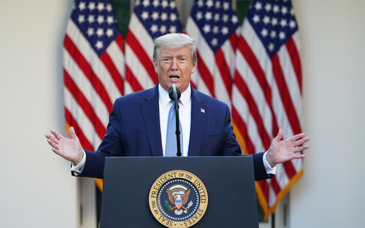 US President Donald Trump gestures as he speaks during the daily briefing on the novel coronavirus, which causes COVID-19, in the Rose Garden of the White House on April 15, 2020, in Washington, DC.