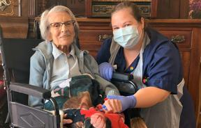 Recovered Covid-19 patient, 106-year-old Connie Titchen (left), with Sister Kelly Smith, posing for a photograph in Birmingham, central England.