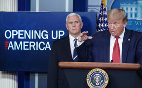 US President Donald Trump flanked by US Vice President Mike Pence, speaks during the daily briefing on the novel coronavirus, which causes COVID-19, in the Brady Briefing Room of the White House on April 16, 2020, in Washington, DC. (Photo by MANDEL NGAN / AFP)