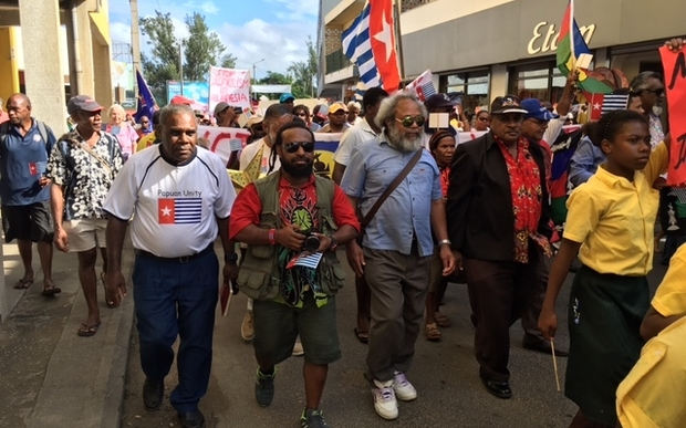 Hundreds of ni-Vanuatu, and West Papuan representatives, march to the Melanesian Spearhead Group secretariat in Port Vila.