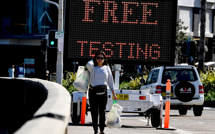 An electronic screen advertises free COVID-19 testing being offered at Bondi Beach in Sydney today.
