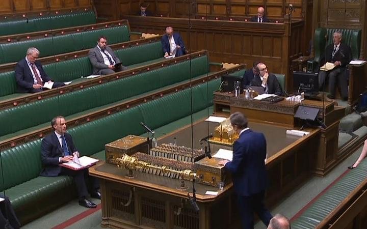 A video grab from footage broadcast by the UK Parliament's Parliamentary Recording Unit (PRU) shows Britain's main opposition Labour Party leader Keir Starmer standing and speaking during Prime Minister's Question time.