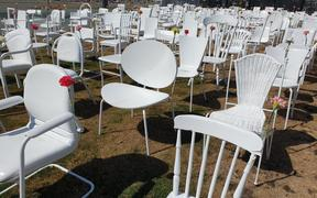The 185 empty chairs memorial - decked with flowers from yesterday's anniversary.