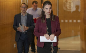 Prime Minister Jacinda Ardern and Director-General of Health Dr Ashley Bloomfield arriving for their Covid-19 update media conference at Parliament, Wellington, on Day 33 of the Covid-19 coronavirus lockdown. 27 April, 2020.