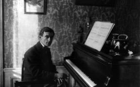 Portrait of Maurice Ravel (1875 - 1937) at the piano.