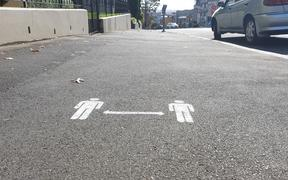 2 metre distance signs on Auckland footpaths on day one of alert level 3 on 28 April.