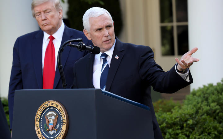 President Donald Trump listens as Vice president Mike Pence answers questions during the daily briefing of the coronavirus task force in the Rose Garden of the White House on April 27, 2020 in Washington, DC.