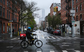 Streets stand nearly empty in the popular Manhattan shopping district of SoHo on 26 April 2020.