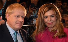 File photo taken on October 02, 2019 Britain's Prime Minister Boris Johnson leaves with his partner Carrie Symonds.