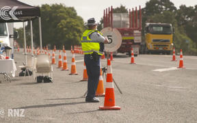 Police help at a Northland community checkpoint under Covid-19 lockdown level 3.
