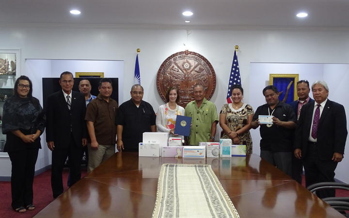 US Ambassador to the Marshall Islands Roxanne Cabral, (centre), met President David Kabua and his Cabinet to officially present Covid-19 related aid